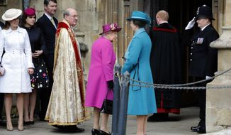 Britain's Queen Elizabeth II, centre and members of the Royal family arrive for the Easter Mattins Service at St. George's Chapel,  Windsor Castle, in Windsor, England, Sunday, April 1, 2018. (Tolga Akmen/Pool Photo via AP)