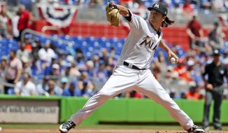 Miami Marlins' Dillon Peters throws during the first inning of a baseball game against the Chicago Cubs, Sunday, April 1, 2018, in Miami. (AP Photo/Wilfredo Lee)