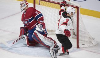 Montreal Canadiens goaltender Carey Price gives up a goal to New Jersey Devils' Taylor Hall during the third period of an NHL hockey game in Montreal, Sunday, April 1, 2018. (Graham Hughes/The Canadian Press via AP)