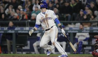 Seattle Mariners' Mitch Haniger watches his two-run home run against the Cleveland Indians during the seventh inning of a baseball game Sunday, April 1, 2018, in Seattle. (AP Photo/Ted S. Warren)