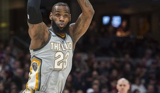 Cleveland Cavaliers' LeBron James (23) passes the ball during the first half of the team's NBA basketball game against the Dallas Mavericks in Cleveland, Sunday, April 1, 2018. (AP Photo/Phil Long)