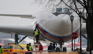A plane carrying Russian diplomats and their family members ordered to leave the U.S. is parked after landing at Vnukovo 2 government airport outside Moscow, Russia, Sunday, April 1, 2018. The United States and more than a dozen European nations kicked out Russian diplomats on Monday and the Trump administration ordered Russia's consulate in Seattle to close, as the West sought joint punishment for Moscow's alleged role in poisoning an ex-spy in Britain. (AP Photo/Alexander Zemlianichenko)