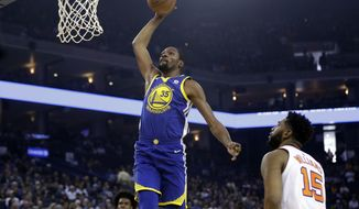 1Golden State Warriors' Kevin Durant (35) goes up for a dunk against the Phoenix Suns during the first half of an NBA basketball game Sunday, April 1, 2018, in Oakland, Calif. (AP Photo/Marcio Jose Sanchez)