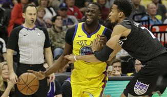 Golden State Warriors forward Draymond Green, left, is fouled by Sacramento Kings forward Skal Labissiere during the first quarter of an NBA basketball game Saturday, March 31, 2018, in Sacramento, Calif. (AP Photo/Rich Pedroncelli)