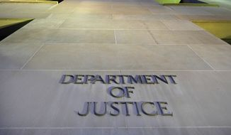 In this May 14, 2013, file photo, the Department of Justice headquarters building in Washington is photographed early in the morning. (AP Photo/J. David Ake, File)  **FILE**