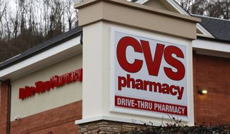 FILE - This Jan. 18, 2017, file photo shows a CVS Pharmacy in Pittsburgh. CVS Health Corp. reports earnings, Thursday, Feb. 8, 2018. (AP Photo/Gene J. Puskar, File)