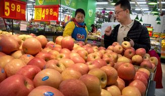 China raised import duties on a $3 billion list of U.S. pork, fruit and other products Monday in an escalating tariff dispute with President Trump that companies worry might depress global commerce. (Associated Press/File)