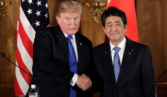 President Donald Trump, left, shakes hands with Japanese Prime Minister Shinzo Abe during a joint news conference at the Akasaka Palace, in Tokyo. Prime Minister Abe has announced plans to visit the U.S. from April 17-20, 2018, to discuss North Korea with President Trump ahead of expected summits between the North and the U.S. and South Korea. (Kiyoshi Ota/Pool Photo via AP, File)