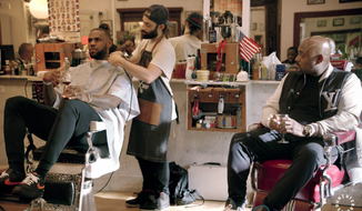 """LeBron James (left) talks and holds a glass of wine while getting a haircut in an episode of his web series, """"The Shop,"""" on media platform Uninterrupted. (Video screenshot via uninterrupted.com)"""