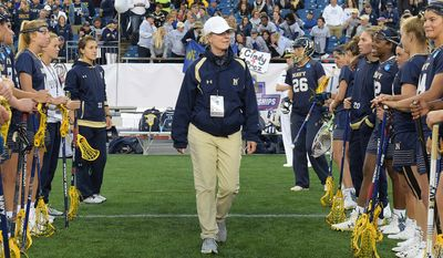 Cindy Timchal, head coach of Navy women's lacrosse, won her 500th career game when the Midshipmen beat Holy Cross 19-7 on Saturday, March 31, 2018. Timchal won eight national titles at Maryland, including seven straight, and is the first women's or men's lacrosse head coach to win 500 games at the Division I level. (Photo by Phil Hoffmann / Navy Sports)