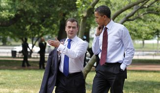 FILE - In this June 24, 2010, file photo, President Barack Obama and Russian President Dmitry Medvedev walk through Lafayette Park from the White House to a attend a meeting at the U.S. Chamber of Commerce in Washington. The Trump administration opened the door to a potential White House meeting between President Donald Trump and Russian President Vladimir Putin, raising the possibility of an Oval Office welcome for Putin for the first time in more than a decade even as relations between the two powers have deteriorated.(AP Photo/J. Scott Applewhite, File) **FILE**