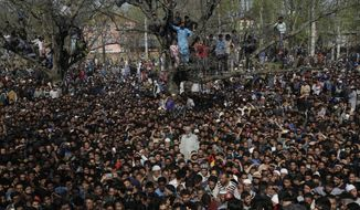 Kashmiri villagers attend the funeral of Zubar Ahmad, one of the killed rebels at Shopian, south of Srinagar, India, Sunday, April 1, 2018. Deadly protests against Indian rule erupted in several parts of Indian-controlled Kashmir on Sunday following the killings of at least eight rebels in fighting with government forces, officials said. At least two army soldiers were also killed in the fighting. (AP Photo/Mukhtar Khan)