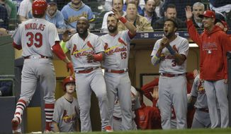 St. Louis Cardinals starting pitcher Miles Mikolas (39) is welcomed back to the dugout after his two-run home run during the fifth inning against the Milwaukee Brewers in the home opener baseball game Monday, April 2, 2018, in Milwaukee. (AP Photo/Jeffrey Phelps)