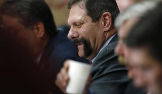 In this Thursday, March 8, 2018, photo, Colorado State Senator Randy Baumgardner, R-Hot Sulphur Springs, listens to debate on a concealed carry bill during action on the floor of the chamber in the State Capitol in Denver. The Republican-led Senate has agreed to debate a Democratic resolution calling for the expulsion of Baumgardner, who is accused of inappropriately touching a former legislative aide. (AP Photo/David Zalubowski)