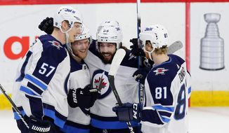 Winnipeg Jets Mathieu Perreault (85) celebrates his game winning goal with teammates Tyler Myers (57), Nikolaj Ehlers (27), Bryan Little (18), and Kyle Connor (81) during third period NHL hockey action against the Ottawa Senators at the Canadian Tire Centre in Ottawa on Monday, April 2, 2018. (Patrick Doyle/The Canadian Press via AP)
