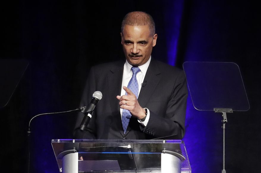 In this file photo, former Attorney General Eric Holder speaks at the Peabody Hotel Monday, April 2, 2018, in Memphis, Tenn. (AP Photo/Mark Humphrey) ** FILE **