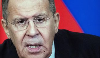 "Russian Foreign Minister Sergey Lavrov speaks to the media during a joint news conference after the talks with his Bangladesh counterpart Abul Hassan Mahmud Ali in Moscow, Russia, Monday, April 2, 2018. Lavrov told reporters on Monday that Moscow is concerned that the United States has been ""gaining a serious foothold"" on the east bank of the Euphrates river despite Trump's earlier promises that the U.S. would leave when the Islamic State group is defeated. (AP Photo/Pavel Golovkin)"