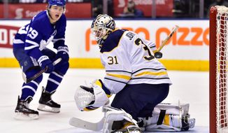 Toronto Maple Leafs centre William Nylander (29) scores his second goal of the period past Buffalo Sabres goaltender Chad Johnson (31) during second period NHL hockey action in Toronto on Monday, April 2, 2018. (Frank Gunn/The Canadian Press via AP)