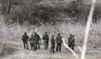 South Korea army soldiers conduct a military exercise in Paju, South Korea, near the border with North Korea, Monday, April 2, 2018. Another spring on the Korean Peninsula, another round of war games by the U.S. and South Korean militaries. This week's drills, however, will feature a new and unusually low-key approach, with the allies resisting bringing in their big guns, and the North, for the time being, avoiding its usual belligerent propaganda against exercises that it claims are an invasion rehearsal. (AP Photo/Ahn Young-joon)