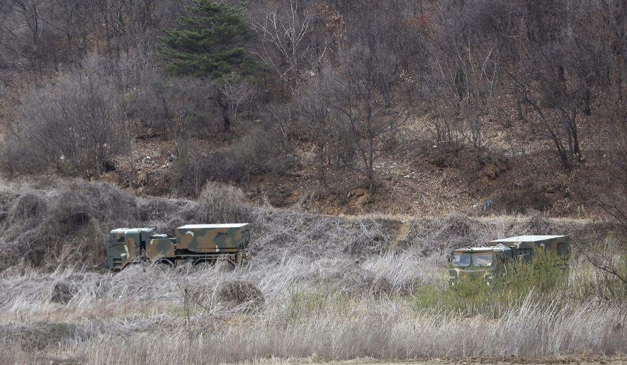 South Korea army's Multiple Launch Rocket System vehicles park during a military exercise in Paju, South Korea, near the border with North Korea, Monday, April 2, 2018. Another spring on the Korean Peninsula, another round of war games by the U.S. and South Korean militaries. This week's drills, however, will feature a new and unusually low-key approach, with the allies resisting bringing in their big guns, and the North, for the time being, avoiding its usual belligerent propaganda against exercises that it claims are an invasion rehearsal. (AP Photo/Ahn Young-joon)