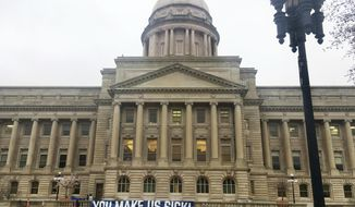 A sign hangs from the Kentucky Capitol on Monday, April 2, 2018, in Frankfort, Ky. Teachers and other public workers are expected to protest recent changes to the pension system and a two-year spending plan lawmakers could approve Monday. (AP Photo/Adam Beam)