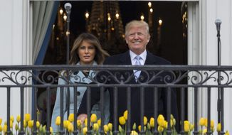 President Donald Trump and first lady Melania Trump arrives on the Truman Balcony of the White House in Washington, Monday, April 2, 2018, for the annual White House Easter Egg Roll. (AP Photo/Carolyn Kaster)