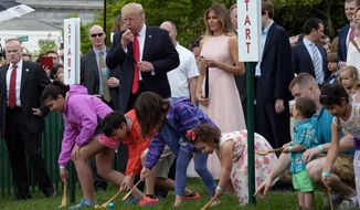 In this April 17, 2017, file photo, President Donald Trump, accompanied by first lady Melania Trump, blows a whistle to begin an Easter Egg Roll race on the South Lawn of the White House in Washington during the annual White House Eastern Egg Roll. The White House is opening the gates for its biggest social event of the year, the annual Easter Egg Roll. Trump and his wife, Melania, are hosting festivities Monday, April 2, 2018, on the South Lawn for a crowd of nearly 30,000 adults and children. (AP Photo/Susan Walsh, File)