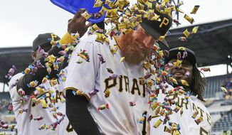 Pittsburgh Pirates' Colin Moran, center, gets a bubble gum shower from teammates Gregory Polanco, left rear, and Josh Bell, right rear, while being interviewed after the Pirates' home opener baseball game against the Minnesota Twins in Pittsburgh, Monday, April 2, 2018. Moran hit a grand slam off Twins starting pitcher Lance Lynn in the first inning to lead the Pirates to a 5-4 win. (AP Photo/Gene J. Puskar)