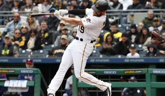 Pittsburgh Pirates' Colin Moran follows through on a grand slam off Minnesota Twins starting pitcher Lance Lynn in the first inning of the Pirates' home opener baseball game in Pittsburgh, Monday, April 2, 2018. (AP Photo/Gene J. Puskar)