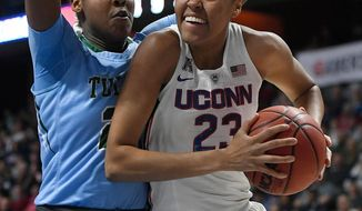 FILE - In this March 4, 2018, file photo, Connecticut's Azura Stevens, right, looks to shoot as Tulane's HarlynWyatt, left, defends during the first half of an NCAA college basketball game in the American Athletic Conference tournament quarterfinals at Mohegan Sun Arena, in Uncasville, Conn. UConn forward Azura Stevens is giving up her last year of eligibility and entering the WNBA draft. The 6-foot-6 junior transfer from Duke says she will miss UConn, but it has been a lifelong dream to play in the WNBA. (AP Photo/Jessica Hill, File)