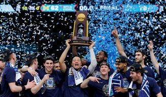 Villanova players celebrate winning the NCAA national championship for the second time in three seasons after Monday's win over Michigan. (ASSOCIATED PRESS)