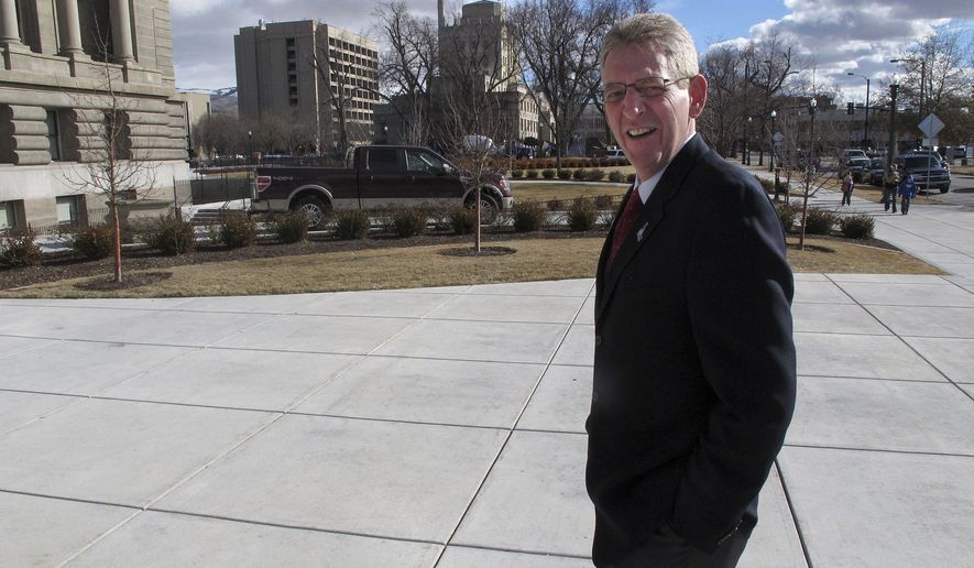 In this photo taken Monday, Jan. 30, 2012, Rep. Bob Nonini, R-Coeur d'Alene, walks toward the Idaho Capitol in Boise on Monday, Jan. 30, 2012. After another Republican representative quit smoking last year, Nonini is the lone open smoker in the Idaho Legislature, a dramatic change from a quarter century ago when lawmakers smoked in caucus meetings and even during hearings on the floor of the House. (AP Photo/John Miller)