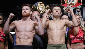 Canelo Alvarez, left, and Gennady Golovkin pose during a weigh-in Friday, Sept. 15, 2017, in Las Vegas. The two are scheduled to fight in a middleweight title fight Saturday in Las Vegas. (AP Photo/John Locher)
