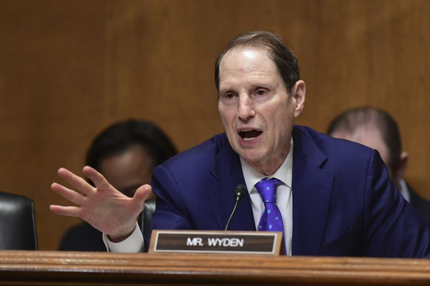 Senate Finance Committee ranking member Sen. Ron Wyden, D-Ore., questions Treasury Secretary Steven Mnuchin during testimony before the committee on Capitol Hill in Washington, Wednesday, Feb. 14, 2018. (AP Photo/Susan Walsh) ** FILE **