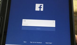 In this June 19, 2017, photo Facebook is launched on an iPad in North Andover, Mass. (AP Photo/Elise Amendola)