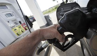 In this April 26, 2017, photo, gas is pumped at a filling station in Nashville, Tenn. (AP Photo/Mark Humphrey)