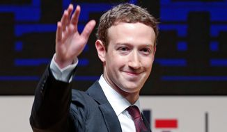 In this Nov. 19, 2016, file photo, Mark Zuckerberg, chairman and CEO of Facebook, waves at the CEO summit during the annual Asia Pacific Economic Cooperation (APEC) forum in Lima, Peru. (AP Photo/Esteban Felix, File)