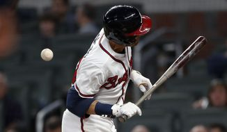 Atlanta Braves' Chris Stewart is hit by a pitch from Washington Nationals reliever Enny Romero during the fourth inning of a baseball game Tuesday, April 3, 2018, in Atlanta. (AP Photo/John Bazemore)