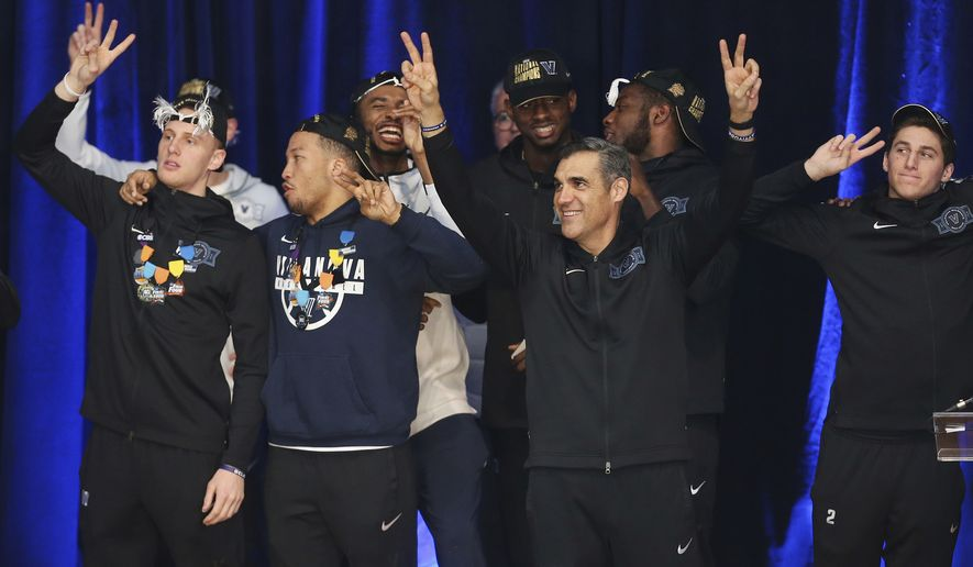 """Villanova men's basketball coach Jay Wright holds up his fingers in """"V"""" signs during a celebration of the team's NCAA tournament championship, at Jake Nevin Field House on Tuesday, April 3, 2018, in Villanova, Pa. (Tim Tai/The Philadelphia Inquirer via AP) **FILE**"""