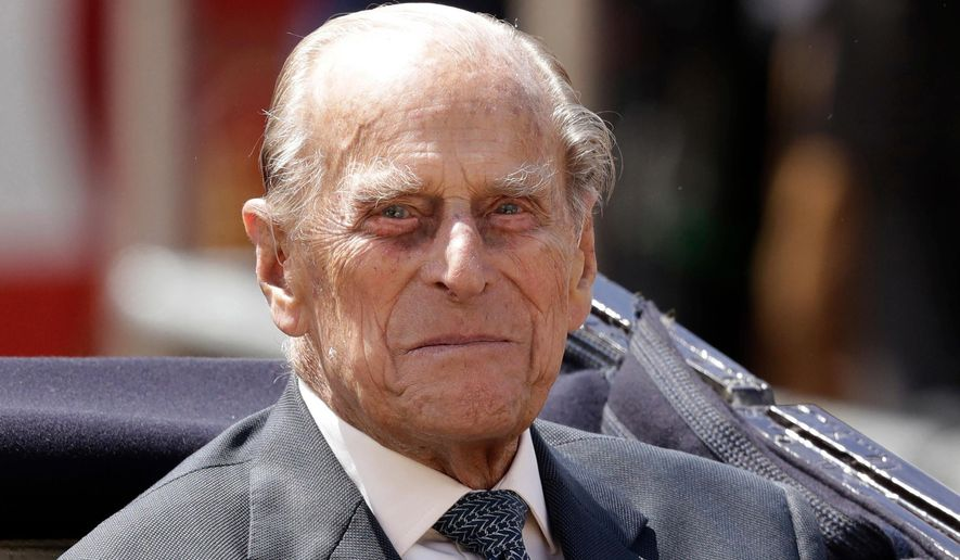 FILE - In this file photo dated Wednesday, July 12, 2017,  Britain's Prince Philip sits in a carriage in London. Buckingham Palace said in a statement Tuesday April 3, 2018, that Queen Elizabeth's husband, Prince Philip, has been admitted to hospital for a previously scheduled hip surgery, that is expected to be carried out Wednesday.  (AP Photo/Matt Dunham, FILE)