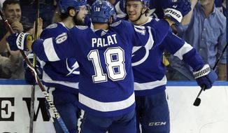 Tampa Bay Lightning center Brayden Point (21) celebrates his goal against the Boston Bruins with right wing Nikita Kucherov (86) and left wing Ondrej Palat (18) during the second period of an NHL hockey game Tuesday, April 3, 2018, in Tampa, Fla. (AP Photo/Chris O'Meara)