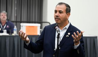 FILE--In this Feb. 24, 2018 file photo, former California State Senator Tony Mendoza (D-Artesia) speaks at a caucus held at the 2018 California Democrats State Convention in San Diego. A former California Senate staffer filed a lawsuit Tuesday, April 3, 2018, alleging she was fired in retaliation for complaining that Mendoza sexually harassed a young woman working in his office on a California State University fellowship. (AP Photo/Denis Poroy, file)