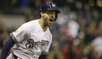 Milwaukee Brewers' Ryan Braun reacts to his walk off home run off of St. Louis Cardinals' Dominic Leon during the ninth inning of a baseball game Tuesday, April 3, 2018, in Milwaukee. (AP Photo/Tom Lynn)