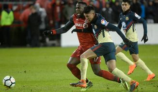 Toronto FC forward Jozy Altidore, left, and Club Amarica defender Edson Alvarez vie for possession during the second half of the first leg in a semifinal of the CONCACAF Champions League soccer tournament Tuesday, April 3, 2018, in Toronto. (Nathan Denette/The Canadian Press via AP)