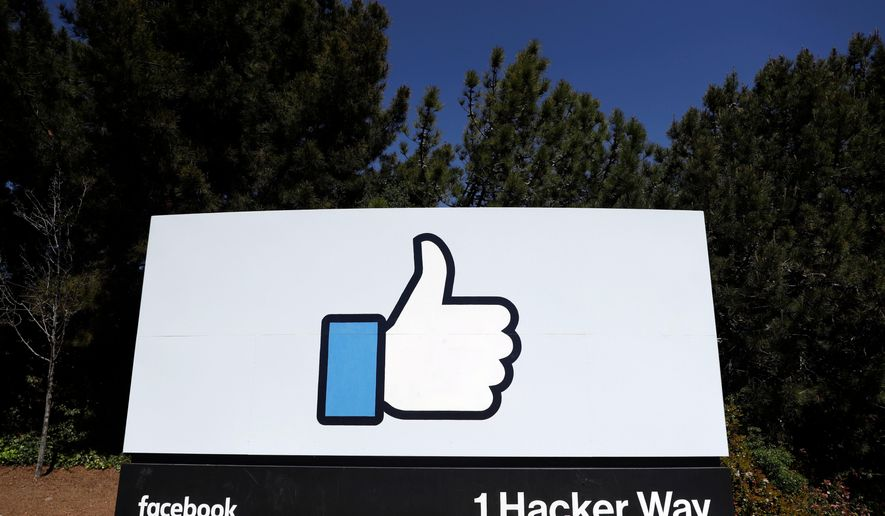"FILE- This March 28, 2018, file photo shows the Facebook logo at the company's headquarters in Menlo Park, Calif. Facebook is asking users whether they think it's ""good for the world"" in a poll sent to an unspecified number of people. (AP Photo/Marcio Jose Sanchez, File)"