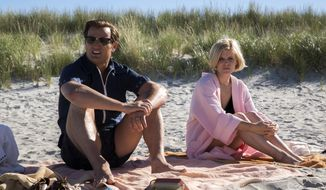 "This image released by Entertainment Studios shows Jason Clarke as Ted Kennedy, left, and Kate Mara as Mary Jo Kopechne in a scene from ""Chappaquiddick."" (Claire Folger/Entertainment Studios via AP)"