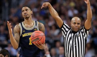Michigan's Charles Matthews (1) reacts to a foul call during the second half in the championship game of the Final Four NCAA college basketball tournament against Villanova, Monday, April 2, 2018, in San Antonio. (AP Photo/Eric Gay)