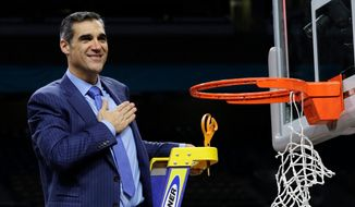Villanova head coach Jay Wright reacts after cutting down the net after beating Michigan 79-62 in the championship game of the Final Four NCAA college basketball tournament, Monday, April 2, 2018, in San Antonio. (AP Photo/David J. Phillip) **FILE**