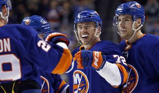 New York Islanders center Anthony Beauvillier (72) celebrates scoring a goal with teammates against the Philadelphia Flyers during the second period of an NHL hockey game in New York, Tuesday, April 3, 2018. (AP Photo/Adam Hunger) ** FILE **
