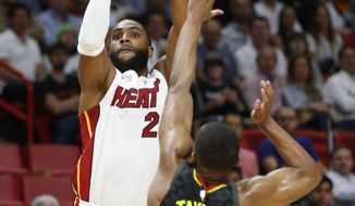 Miami Heat guard Wayne Ellington (2) shoots over Atlanta Hawks guard Isaiah Taylor (22) during the first half of an NBA basketball game Tuesday, April 3, 2018, in Miami. (AP Photo/Wilfredo Lee)